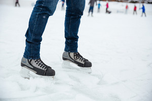 Man's legs in ice skates