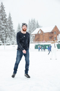 Happy man in ice skates having fun outdoors