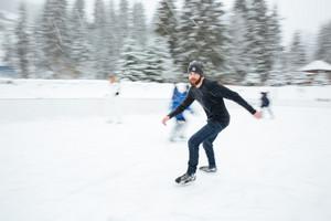 Man ice skating outdoors