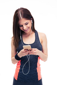 Smiling sporty woman using smartphone