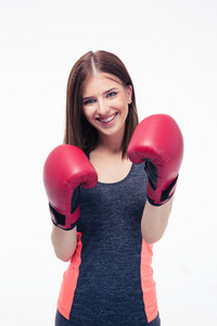 Cheerful fitness woman in boxing gloves