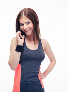 Smiling fitness cute woman talking on the phone