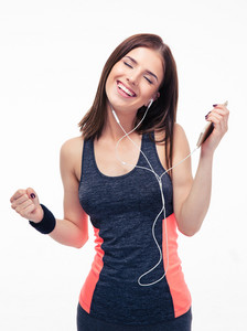 Happy sporty woman listening music in headphones