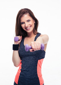 Cheerful woman working out with dumbbells