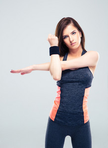 Cute fitness woman stretching hands