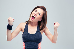 Angry young sports woman shouting