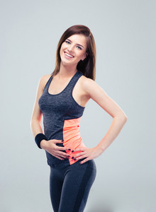 Cheerful fitness woman looking at camera