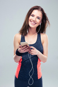 Smiling fitness woman with smartphone