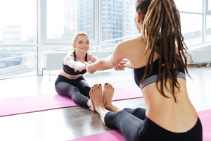 Two women working out in yoga studio together