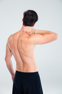 Back view portrait of a man having neck pain