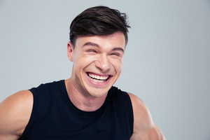 Portrait of a funny man laughing