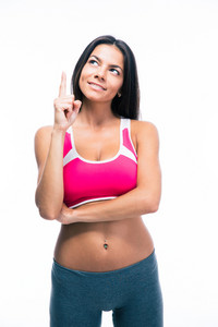 Happy fitness woman pointing finger up