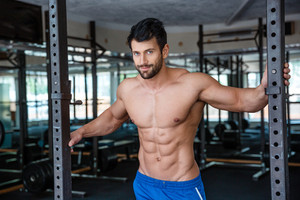 Man resting in fitness gym