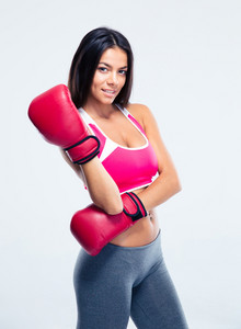 Smiling sporty woman in boxing gloves