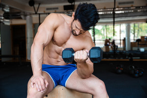 Handsome man workout with dumbbell