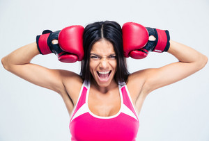 Fitness woman with boxing gloves screaming