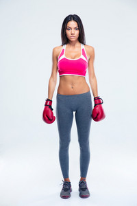 Serious fitness woman in boxing gloves