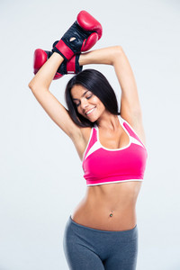 Happy fitness woman in boxing gloves