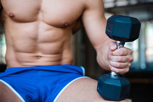 Man workout holding dumbbell