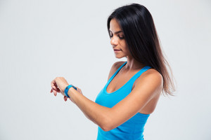 Fitness woman using fitness tracker