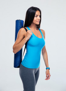 Fitness woman holding yoga mat