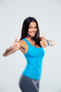Sporty woman showing thumb up sign