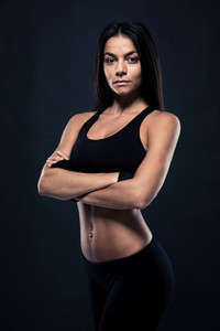 Fitness woman standing with arms folded