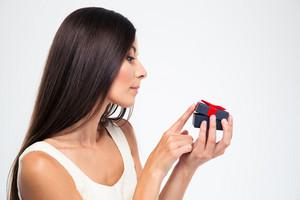 Woman opening jewerly gift box