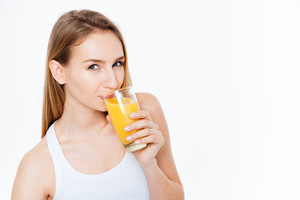Charming woman drinking fresh juice