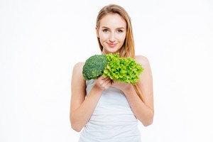 Woman holding cauliflower and green salad