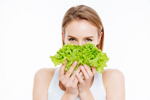 Cute woman holding green salad