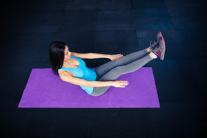 Woman doing excercise on yoga mat