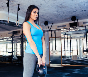 Beautiful woman working out with weight