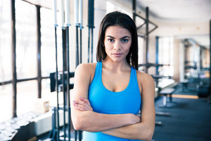Beautiful fitness woman with arms folded