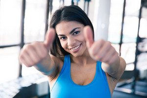 Happy beautiful woman showing thumb up