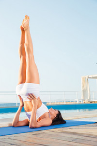 Woman doing a shoulder stand