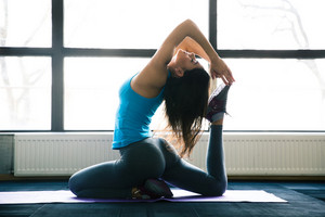 Young woman doing yoga exercises