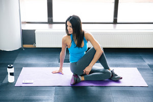 Young woman working out on yoga mat