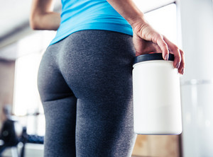 Closeup image of female body at gym