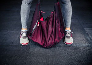 Female legs and sports bag