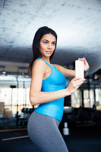 Happy fit woman making selfie photo