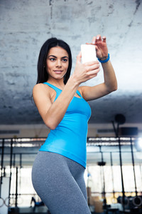 Sports woman making selfie on smartphone