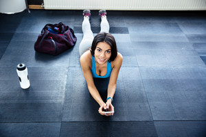 Fit woman lying on the floor at gym