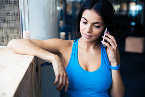 Beautiful fit woman talking on the phone