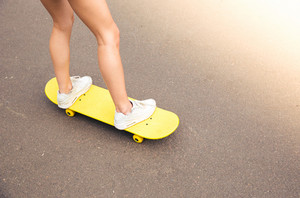 Female legs on skateboard