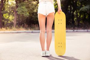 Female legs with skateboard