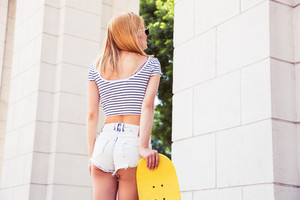 Sexy female teenager with skateboard