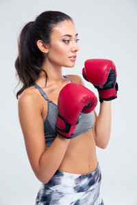 Beautiful fitness woman with boxing gloves