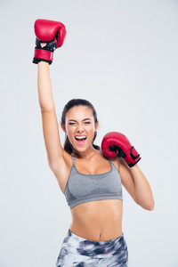 Fitness woman with boxing gloves celebrating her victory