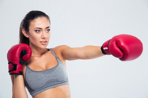 Portrait of fitness woman boxing in gloves